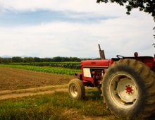 Tractor with agriculture fields in background